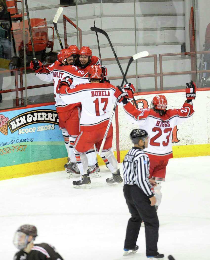 Rensselaer Polytechnic Institute players celebrate a Mike Zalewski goal against Brown University's during the second period of a ECAC college hockey game in Troy N.Y., Sunday, March 17, 2012. (Hans Pennink / Special to the Times Union) College Sports.