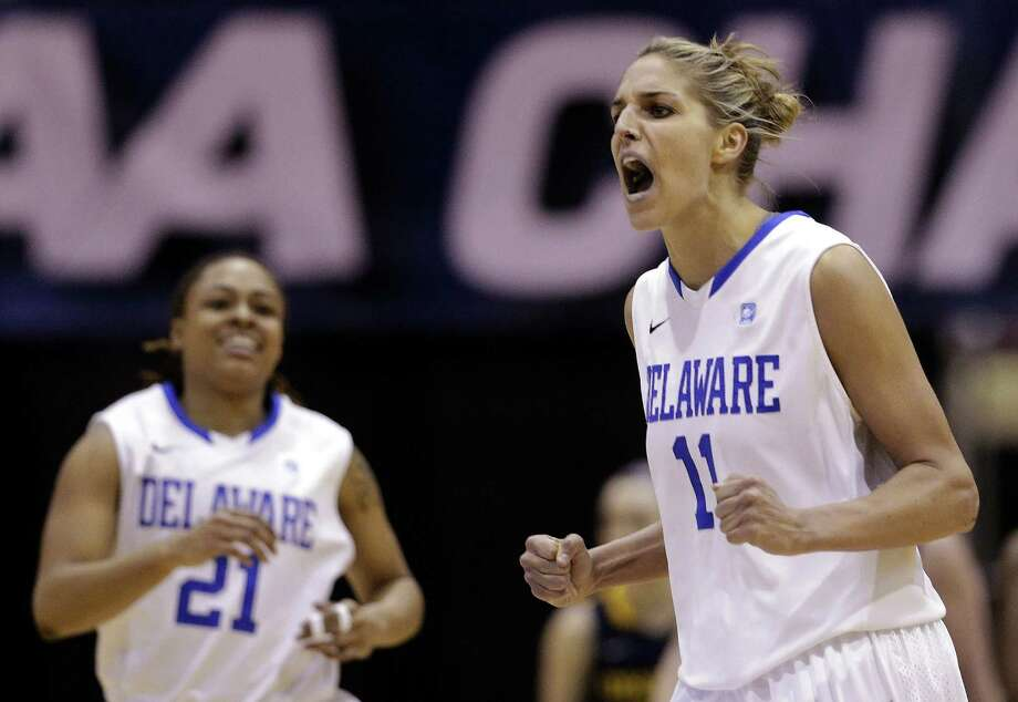 Delaware's Elena Delle Donne (right), named the CAA tournament MVP, scored 28 points in Sunday's win over Drexel, the Blue Hens' 25th in a row. At left is teammate Trumae Lucas. Photo: Patrick Semansky / Associated Press