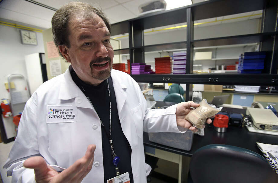 Michael Wargovich, a professor of molecular medicine at the University of Texas Health Science Center, displays a small bag of mixed plant life remedies as he talks about his research on foods that inhibit cancer. Wargovich is studying foods with anti-inflammatory properties, including fruits, vegetables, spices and herbs. Photo: Tom Reel / San Antonio Express-News