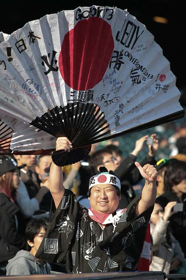 A fan signals to team Japan players before the start of the World Baseball Classic semi-final game between Puerto Rico and Japan in San Francisco on Sunday, March 17, 2013. Photo: Mathew Sumner, Special To The Chronicle