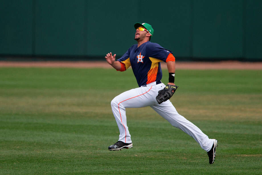 Astros outfielder J.D. Martinez call out for the ball during the first inning. Photo: Evan Vucci