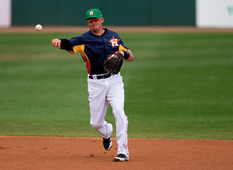 Astros infielder Tyler Greene throws to first during the first inning. Photo: Evan Vucci