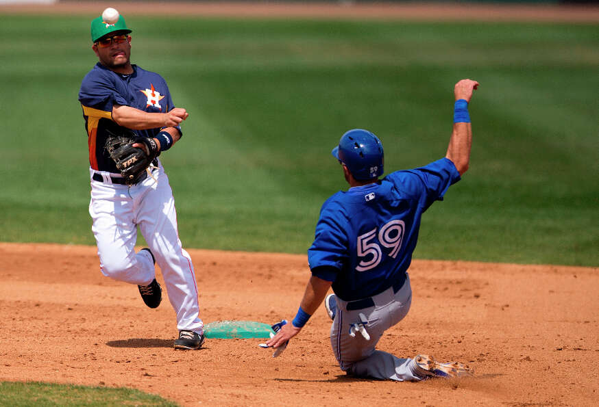 Jim Negrych, right, slides into second base as Astros infielder Jose Altuve turns a double play duri