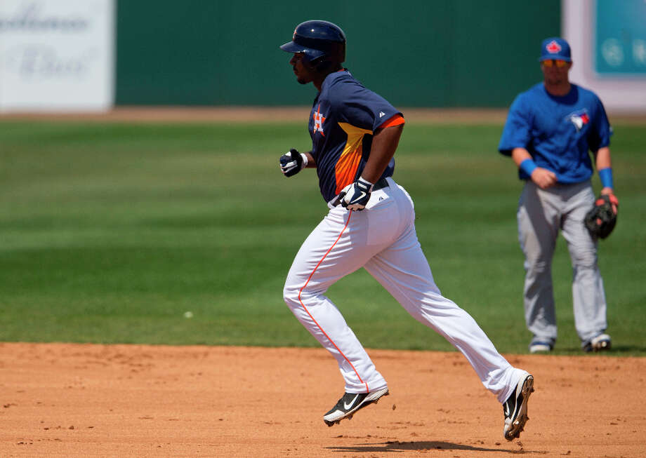 Chris Carter rounds the bases after hitting his second home run. Photo: Evan Vucci