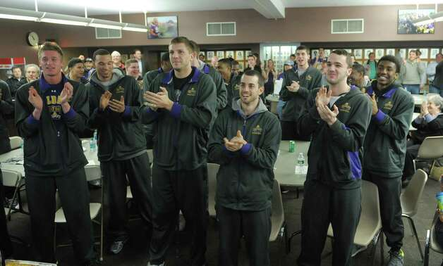 University at Albany men's basketball players, from left to right, Dave Wiegmann, Gary Johnson, Blake Metcalf, Jacob Lati, Peter Hooley and Reece Williams XXX at they watch the NCAA selection show on Sunday, March 17, 2013 at the SEFCU Arena in Albany, NY.  (Paul Buckowski / Times Union) Photo: Paul Buckowski