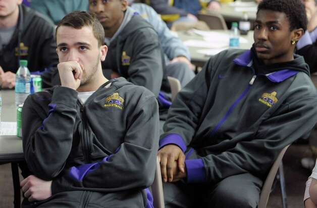 University at Albany men's basketball players, Peter Hooley, let,  and Reece Williams, right, watch the NCAA selection show on Sunday, March 17, 2013 at the SEFCU Arena in Albany, NY.  (Paul Buckowski / Times Union) Photo: Paul Buckowski