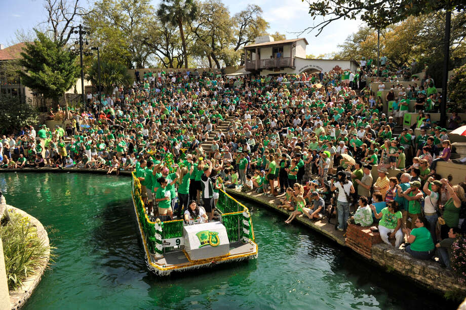 A float in the St. Patrick's Day River Parade draws cheers from the crowd at the Arneson River Theatre. The San Antonio River is dyed green each year in honor of St. Patrick's Day. Photo: Robin Jerstad / For The San Antonio Express-News