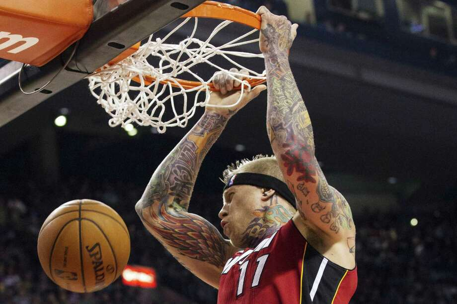 """Miami's Chris """"Birdman"""" Andersen dunks against Toronto during the first half. The Heat will try to win their 23rd consecutive game today against the Celtics in Boston. Photo: Chris Young / Associated Press"""