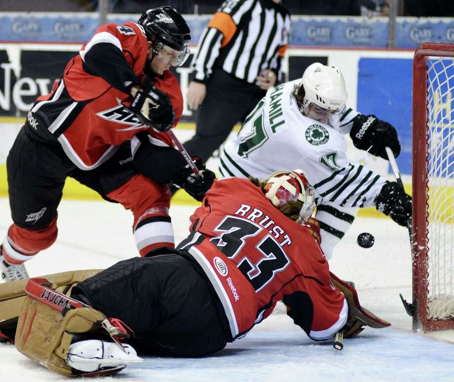 Abbotsford goaltender Barry Brust (33) dives to make a save on the Rampage's Zach Hamill. Photo: Darren Abate / Pressphotointl.com