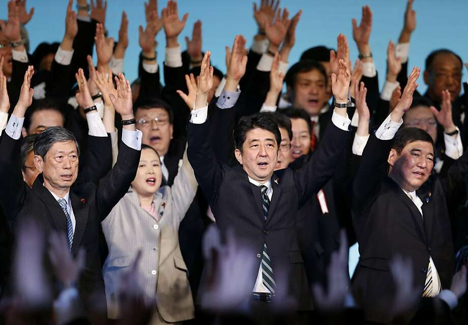 "Japan's Prime Minister Shinzo Abe, center, and his Liberal Democratic Party lawmakers shout traditional ""Banzai (long life)"" cheers during the annual party convention at a hotel in Tokyo Sunday, March 17, 2013. The conservative LDP recaptured power after December Lower House election.  Photo: Shizuo Kambayashi, Associated Press"