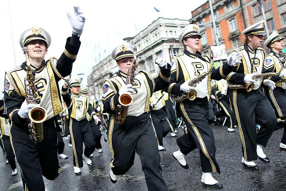 Members of the US University, Purdue run along the parade route during St Patrick's Day festivities in Dublin on March 17, 2013. More than 100 parades are being held across Ireland to mark St Patrick's Day, the feast day of the patron saint of Ireland, with up to 650,000 spectators expected to attend the parade in Dublin. Ireland has high hopes that the festivities will bring a much-needed boost to the economy.  Photo: Peter Muhly, AFP/Getty Images
