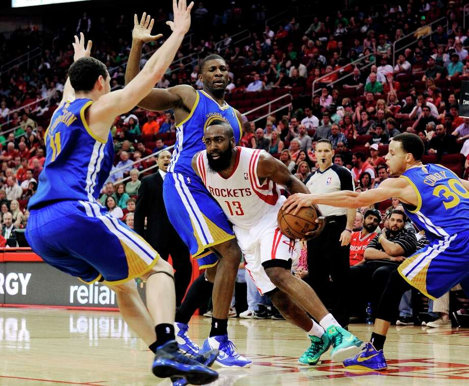 James Harden (13) tries to get past Warriors defenders Klay Thompson (11), Stephen Curry (30) and Festus Ezeli in the second half. Photo: Pat Sullivan