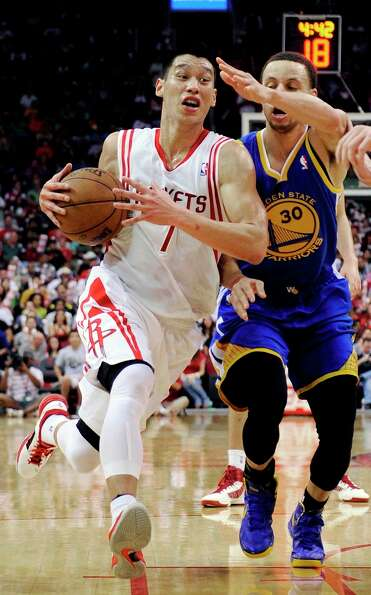 Jeremy Lin is pressured by Stephen Curry during the second half.