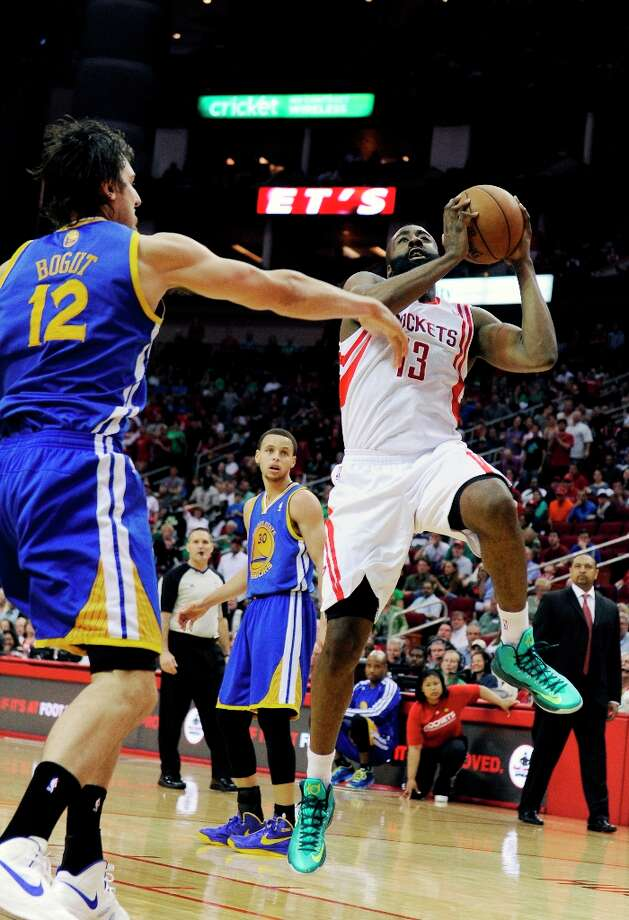 James Harden goes up for a shot in front of Warriors center Andrew Bogut (12) in the second half. Photo: Pat Sullivan