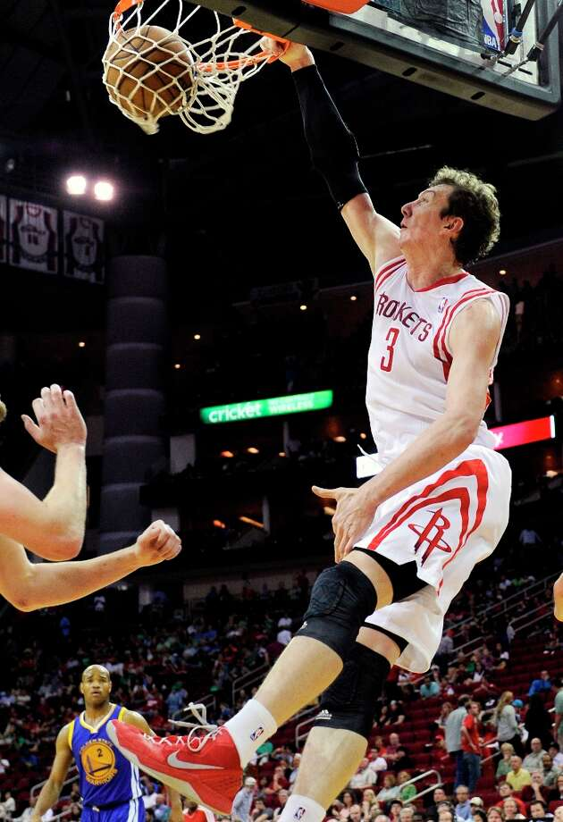 Rockets center Omer Asik slam dunks the ball during the second half. Photo: Pat Sullivan