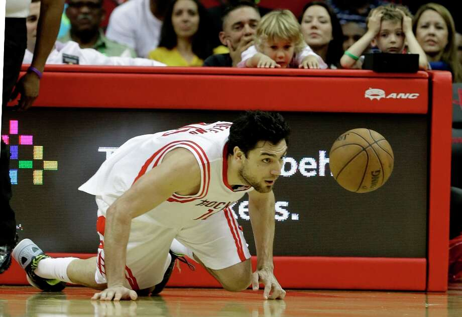 Young fans look on as Carlos Delfino goes after a loose ball in the second half. Photo: Pat Sullivan