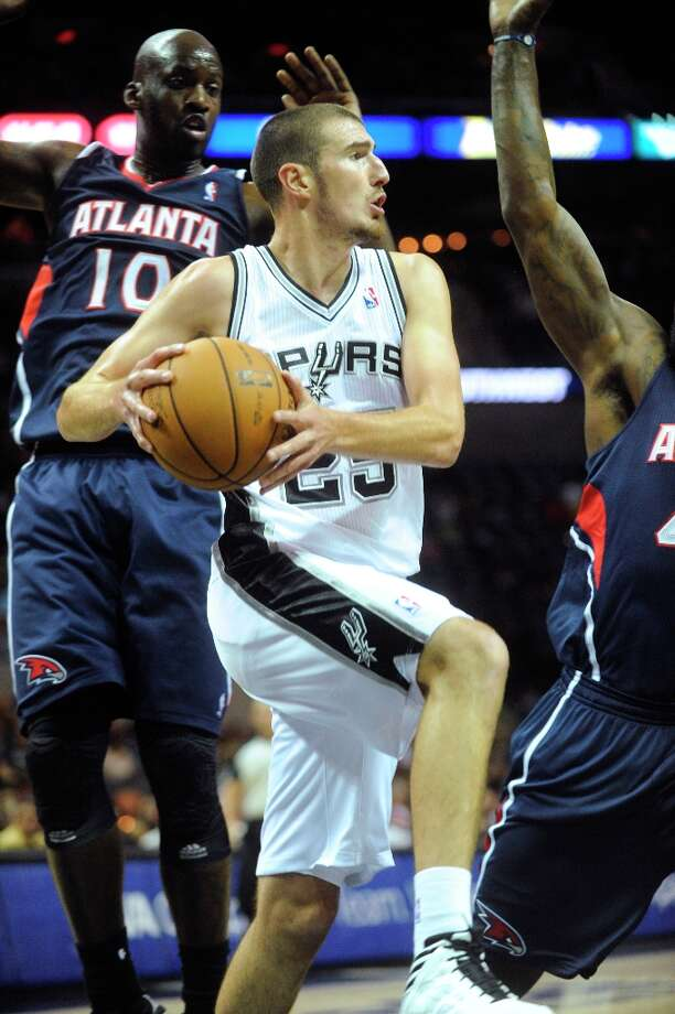 Nando de Colo of the Spurs passes off against Atlanta during preseason NBA action at the AT&T Center on Wednesday, Oct. 10, 2012. Photo: Billy Calzada, San Antonio Express-News / © San Antonio Express-News