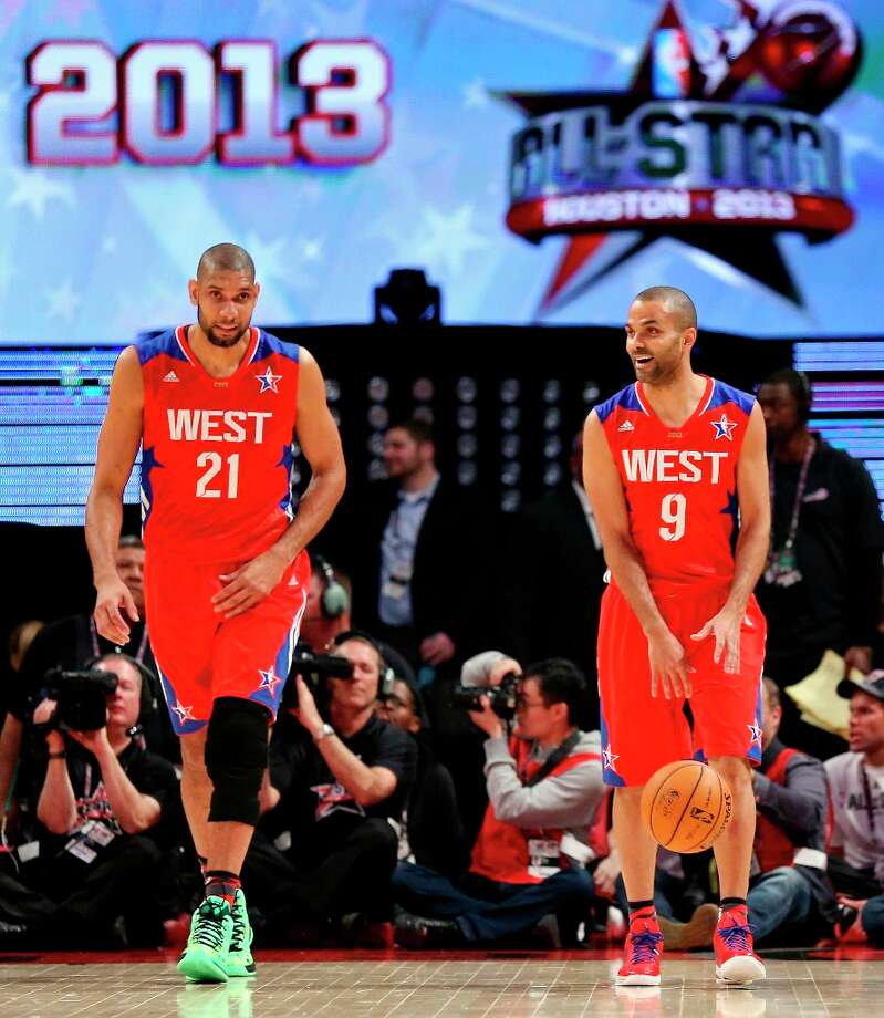 The West's Tim Duncan and Tony Parker head up court against the East during first half action of the 62nd All-Star Game at the Toyota Center Sunday Feb. 17, 2013 in Houston. Photo: Edward A. Ornelas, San Antonio Express-News / © 2013 San Antonio Express-News