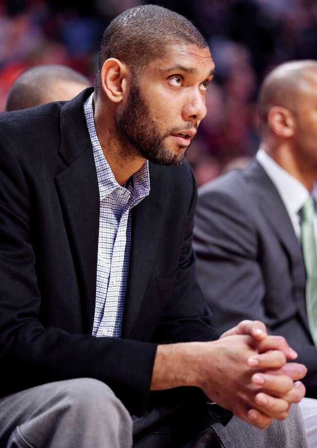 The Spurs' Tim Duncan watches second half action against the Chicago Bulls from the bench Monday Feb. 11, 2013 at the United Center in Chicago. The Spurs won 103-89. Photo: Edward A. Ornelas, San Antonio Express-News / © 2013 San Antonio Express-News