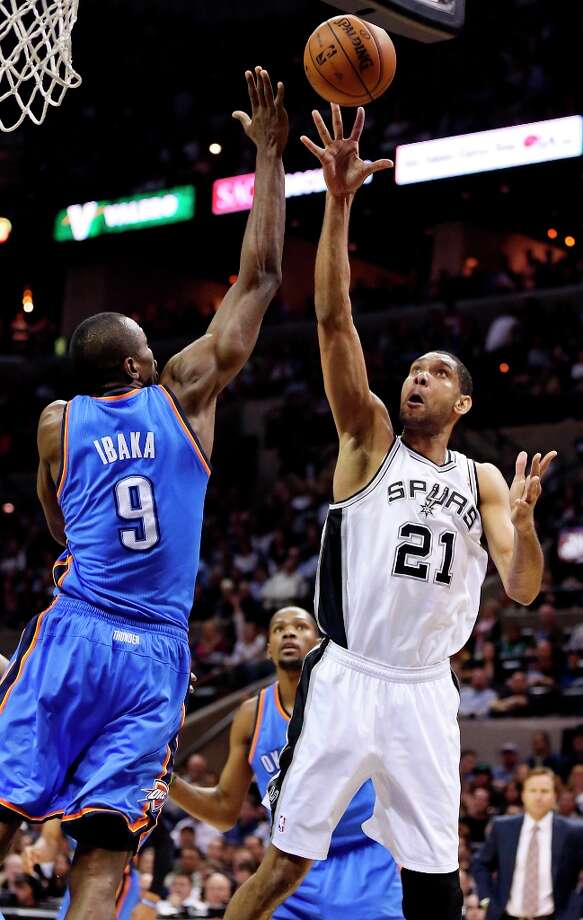 The Spurs' Tim Duncan shoots around Oklahoma City Thunder's Serge Ibaka during second half action Monday March 11, 2013 at the AT&T Center. The Spurs won 105-93. Photo: Edward A. Ornelas, San Antonio Express-News / © 2013 San Antonio Express-News