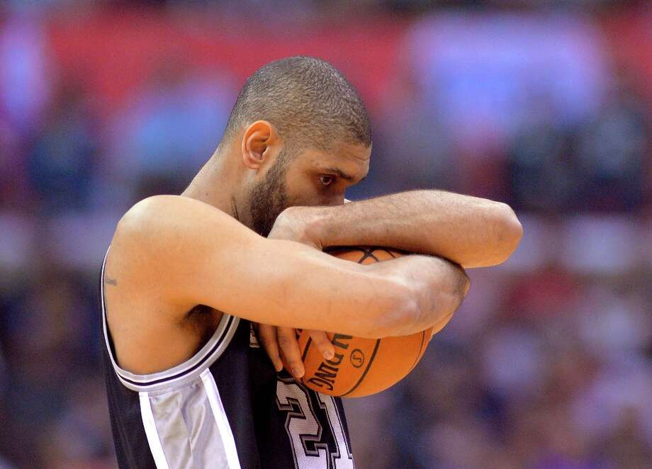 Spurs power forward Tim Duncan hugs the ball prior to their game against the Los Angeles Clippers, Thursday, Feb. 21, 2013, in Los Angeles. Photo: Mark J. Terrill, Associated Press / AP