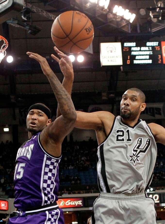 Sacramento Kings center DeMarcus Cousins (left) and Spurs forward Tim Duncan go after a rebound during the first quarter in Sacramento, Calif., Tuesday, Feb. 19, 2013. Photo: Rich Pedroncelli, Associated Press / AP
