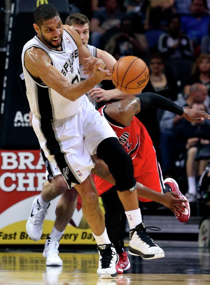 Tim Duncan comes up with a steal and fires the ball downcourt as the Spurs play the Portland Trailblazers at the AT&T Center on March 8, 2013. Photo: TOM REEL