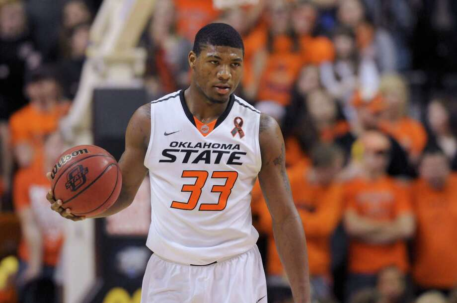 Oklahoma State guard Marcus Smart holds the ball during an NCAA basketball game in Stillwater, Okla., Saturday, Mar. 2, 2013. Oklahoma State defeated Texas 78-65. (AP Photo/Brody Schmidt) Photo: BRODY SCHMIDT, FRE / FR79308 AP