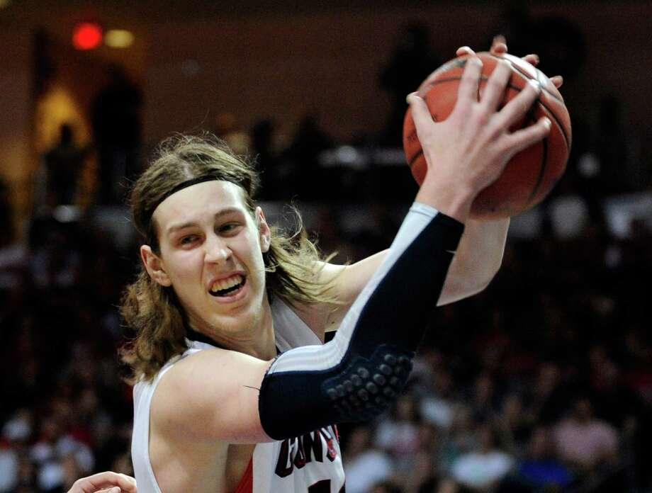 LAS VEGAS, NV - MARCH 11:  Kelly Olynyk #13 of the Gonzaga Bulldogs grabs a rebound during the championship game of the West Coast Conference Basketball tournament against the Saint Mary's Gaels at the Orleans Arena March 11, 2013 in Las Vegas, Nevada.  Gonzaga won 65-51. Photo: David Becker, Getty Images / 2013 Getty Images