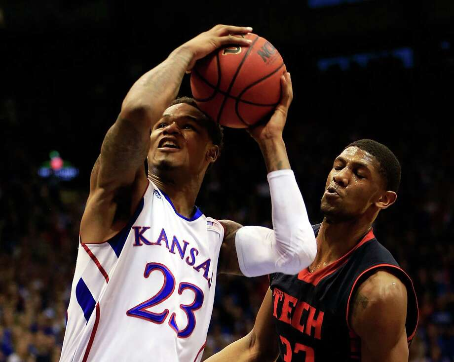 LAWRENCE, KS - MARCH 04:  Ben McLemore #23 of the Kansas Jayhawks shoots as Jordan Tolbert #32 of the Texas Tech Red Raiders defends during the game at Allen Fieldhouse on March 4, 2013 in Lawrence, Kansas. Photo: Jamie Squire, Getty Images / 2013 Getty Images