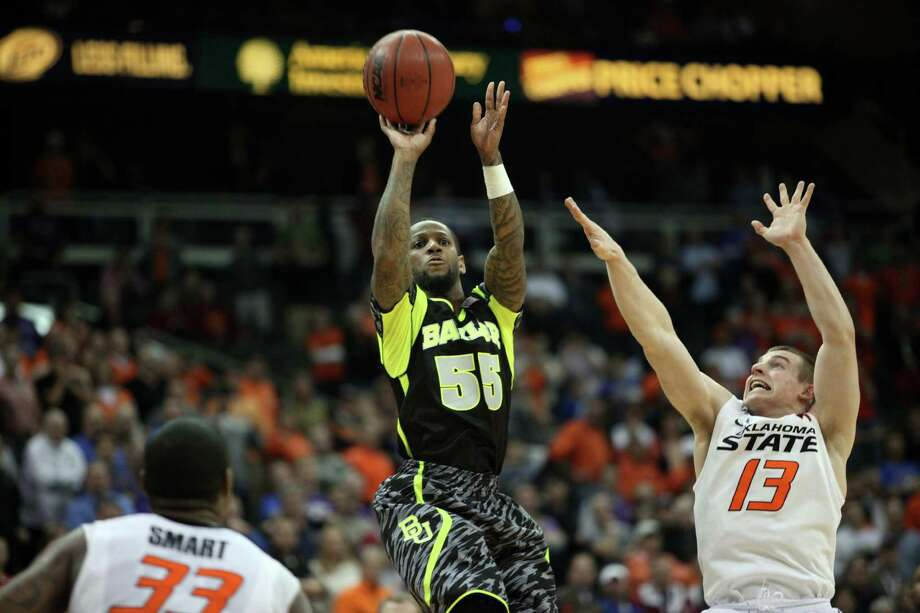 In this Thursday, March 14, 2013 photo, Baylor guard Pierre Jackson (55) misses a last-second basket as Oklahoma State's Phil Forte (13) defends during the second half of an NCAA college basketball game in the Big 12 tournament in Kansas City, Mo. Oklahoma State won 74-72. (AP Photo/The Daily Texan, Lawrence Peart) Photo: Lawrence Peart, Associated Press / Daily Texan