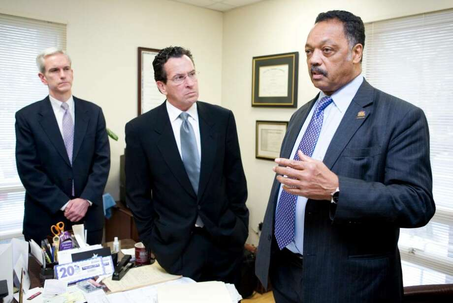 The Rev. Jesse Jackson, right, talks to the press before speaking to a group at the Faith Tabernacle Baptist Church in Stamford on the subject of economic exclusivity. With him is Senator Andrew McDonald, left, and former Stamford mayor Dannel Malloy. Photo: Kerry Sherck / Stamford Advocate Freelance