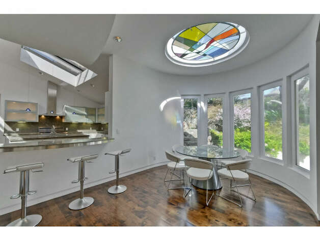 Small eating nook off the kitchen with stained glass skylight