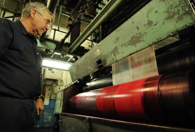 Times Union pressman George Allen attends to the Times Union's Goss Headliner MKII press during a production run Monday evening in Colonie, N.Y. Dec. 12, 2011. (Will Waldron / Times Union) Photo: Will Waldron