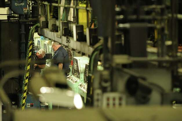 Times Union pressmen George Allen, left, and Tom Wagoner, attend to the Times Union's Goss Headliner MKII press during a production run Monday evening in Colonie, N.Y. Dec. 12, 2011.  (Will Waldron / Times Union) Photo: Will Waldron