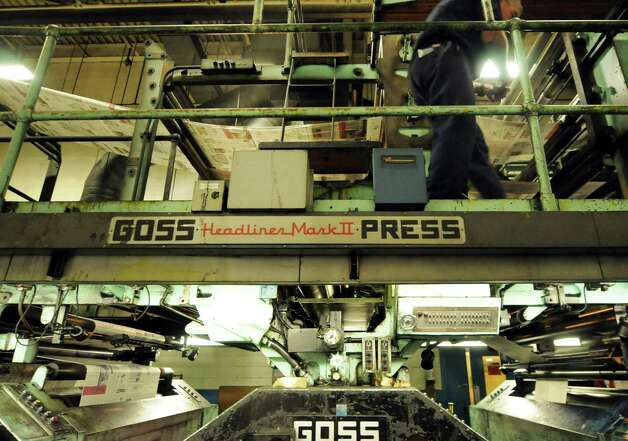 George Allen, Times Union pressman, right, attends to the Times Union's Goss Headliner MKII press during a production run Monday evening in Colonie, N.Y. Dec. 12, 2011. (Will Waldron / Times Union) Photo: Will Waldron