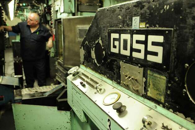 Times Union pressman Tom Wagoner attends to the paper's Goss Headliner MKII press during a production run Monday evening in Colonie, N.Y. Dec. 12, 2011. (Will Waldron / Times Union) Photo: Will Waldron