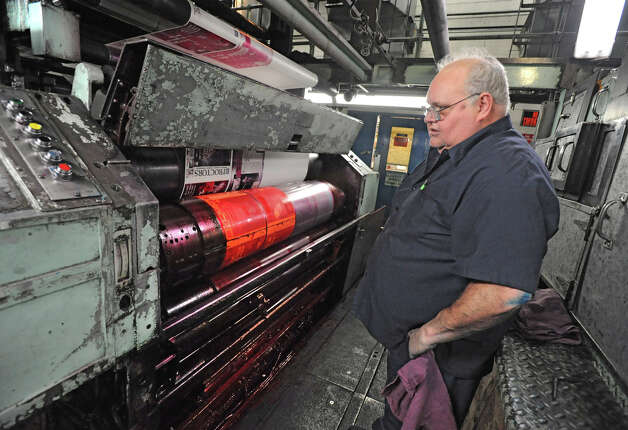 Pressman Tom Wagner works on part of the press in the Times Union pressroom Wednesday, Feb. 22, 2012 in Colonie, N.Y.  (Lori Van Buren / Times Union) Photo: Lori Van Buren