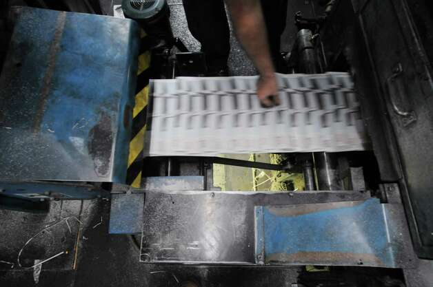 George Allen pulls a paper off to check the quality of the  Goss letter press in the pressroom at the Times Union in Colonie, NY on Monday, March 31, 2008.   (Paul Buckowski/Times Union) Photo: Paul Buckowski / Albany Times Union