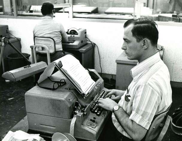 Copy is entered and then encoded onto a perforated strip during the page composing process at the Times Union in Colonie, N.Y. The perforated strip was then input into a computer, undated photo. (Times Union archive)