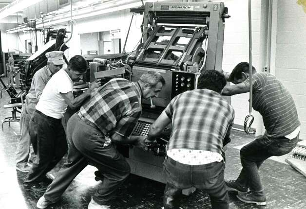 Linotype machines are removed from Times Union, formerly Capital Newspapers, in Colonie, N.Y., undated photo. (Times Union archive)