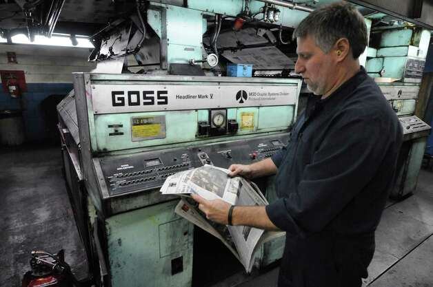 Times Union pressmen Robert Bottari examines newsprint for registration color correction early Sunday morning, Feb. 17, 2013, at the Times Union in Colonie, N.Y. Press operators constantly examine print and make adjustments to the press during the entire run. The Times Union?s Goss Headliner press was installed in 1970. (Will Waldron/Times Union) Photo: Will Waldron