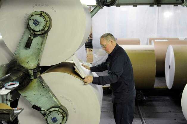 Bill Parker preps a roll of newsprint for splicing early Sunday morning, Feb. 17, 2013, at the Times Union in Colonie, N.Y. (Will Waldron/Times Union) Photo: Will Waldron