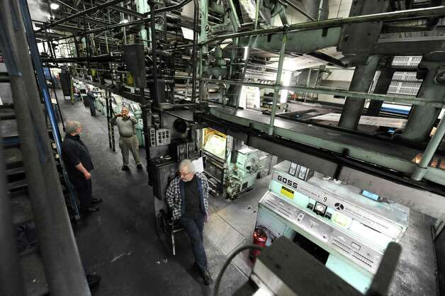 Pressmen take photos before the last run of the old Goss press at the Times Union on Sunday, March 17, 2013 in Colonie, N.Y.  (Lori Van Buren / Times Union) Photo: Lori Van Buren