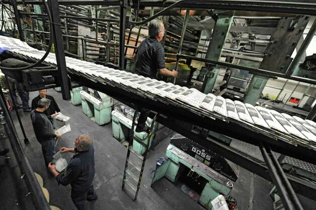 Pressman in charge Al Veve climbs the ladder for one of the last times during the final run of the old Goss press at the Times Union on Monday, March 18, 2013 in Colonie, N.Y.  (Lori Van Buren / Times Union) Photo: Lori Van Buren