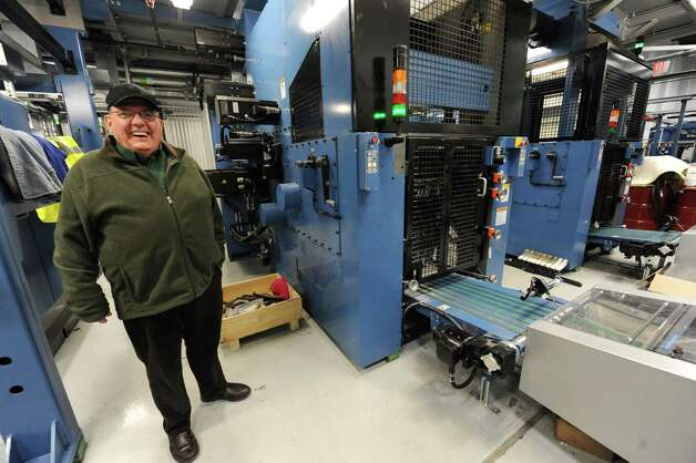 Retired pressman Bob Harrington checks out the new press at the Times Union on Monday, March 18, 2013 in Colonie, N.Y. Bob retired in 1989 and came to witness the last run on the old Goss press.  (Lori Van Buren / Times Union) Photo: Lori Van Buren