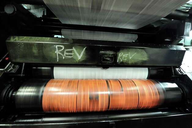 The Times Union newspaper is printed on the the old Goss press during it's final run at the Times Union on Monday, March 18, 2013 in Colonie, N.Y.  (Lori Van Buren / Times Union) Photo: Lori Van Buren