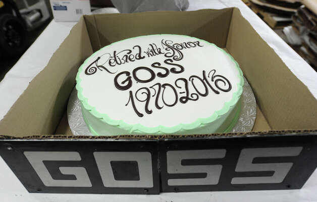 A cake awaits the pressman to eat after the last run of the old Goss press at the Times Union on Monday, March 18, 2013 in Colonie, N.Y.  (Lori Van Buren / Times Union) Photo: Lori Van Buren