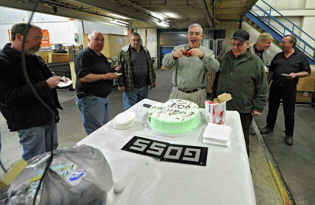 Pressmen of past and present enjoy cake commemorating the last run of the old Goss press at the Times Union on Monday, March 18, 2013 in Colonie, N.Y.  (Lori Van Buren / Times Union) Photo: Lori Van Buren