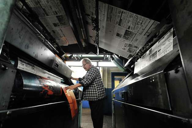 Pressman Robert Barron puts on plates for the last run of the old Goss press at the Times Union on Monday, March 18, 2013 in Colonie, N.Y.  (Lori Van Buren / Times Union) Photo: Lori Van Buren